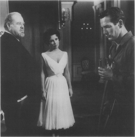 Big Daddy (Burl Ives) and Maggie (Elizabeth Taylor) regard the troubled Brick (Paul Newman) in a scene from the 1958 film adaptation