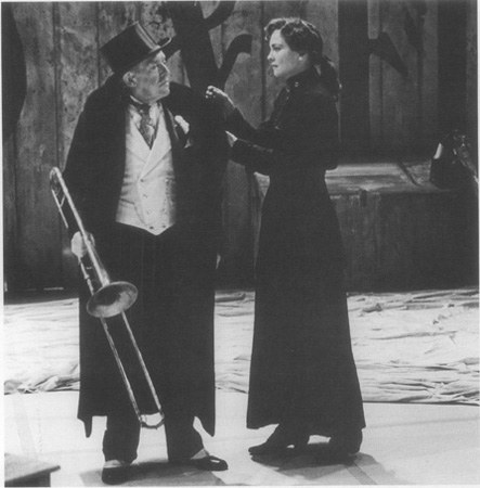 Undershaft (holding trombone) visits Barbara at the Salvation Army in an American Repertory Theatre production of Shaws play