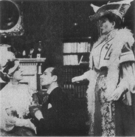 John Worthing (John Gielgud, who also directed the production) woos the hand of Gwendolen (Gwen Frangeon-Davies) as Lady Bracknell (Edith Evans) observes. This production of The Importance of Being Earnest was staged at the Globe Theatre in 193