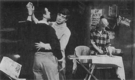 A 1956 production of Look Back in Anger. Jimmy Porter (Kenneth Haigh) dances with Cliff (Alan Bates) while Jimmys wife, Alison, irons