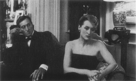 A scene from the 1985 film adaptation: Brock (Charles Dance) regards his unhappy wife, Susan