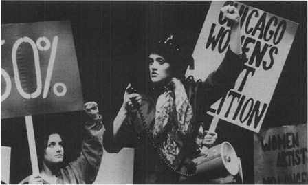 The art museum protest scene, in which Heidi and her friends demand that the gallery display more works by female artists
