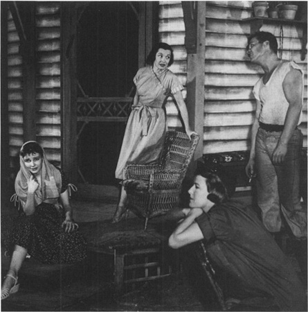A scene from the 1958 Broadway production; Madge (Janice Rule) is seated on the porch while Flo (Peggy Conklin) talks with Hal (Ralph Meeker), Millie (Kim Stanley) is in the foreground