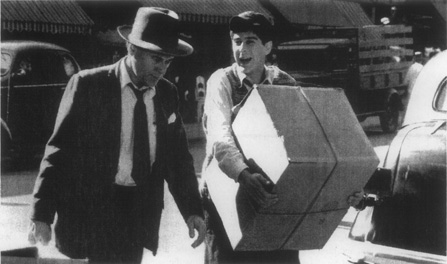 Jack Jerome (Bob Dishy) is accompanied home by his son Eugene, returning from one of his many errands
