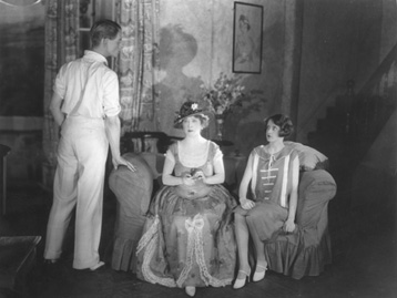 Marie Tempest (centre) stars in a 1925 production of Hay Fever at The Ambassadors Theatre in London