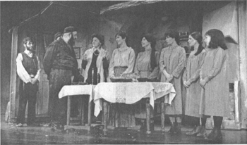 Zero Mostel as Tevye (second from left) addresses his wife and daughters in a 1965 Broadway production