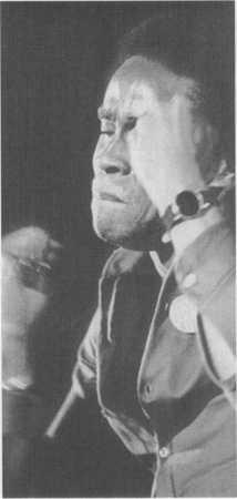 Carl Anderson as Judas sings a song in the stage production