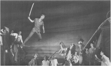 An example of the special effects used to heighten the stage presentation: Peter (Mary Martin) takes flight (with the aid of a cable and harness) in a battle with Captain Hook