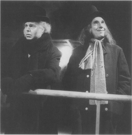 Peer (Derek Jacobi, on the left) aboard the ship just before the fateful wreck