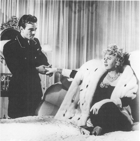 Peter Folk and Shelley Winters in a scene from the 1963 film adaptation of The Balcony.