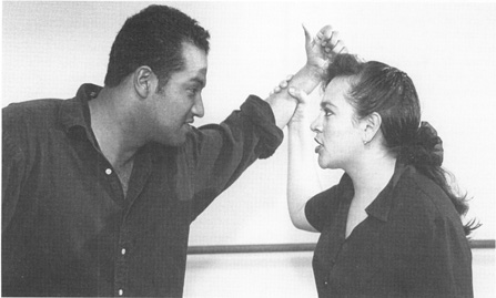 Juan Maza, as Leonardo, fighting with Grisel Ayala, as his wife, in a scene from Blood Wedding, performed at California State University, Los Angeles.