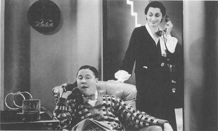 Jack Oakie, as George Lewis, and Aline MacMahon, as May Daniels, in a scene from the 1932 film adaptation of Once in a Lifetime.