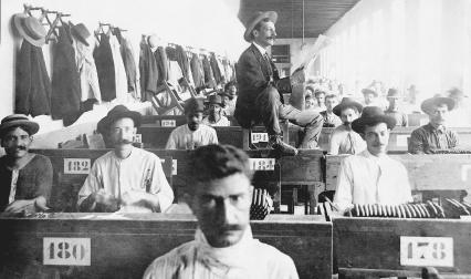 A hired reader and cigar makers in Cuba circa 1910
