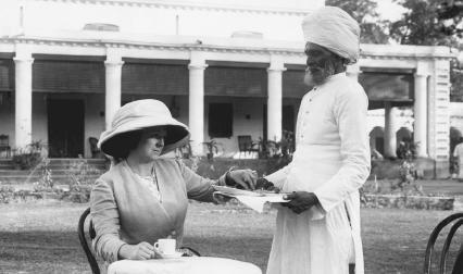 A Hindu man serving tea to a European colonial woman