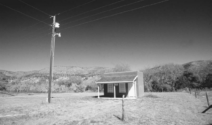 Isolated building in Lincoln, New Mexico  Reinhard EiseleCorbis