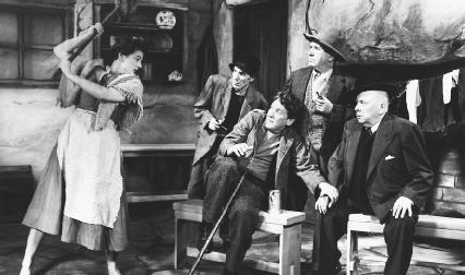 A scene from a theatrical production of The Playboy of the Western World, written by J. M. Synge