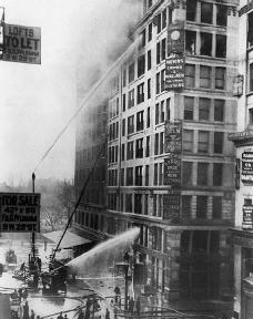 Firefighters try to put out the fire at the Triangle Shirtwaist Factory.