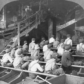 Breaker boys separating rock from coal.