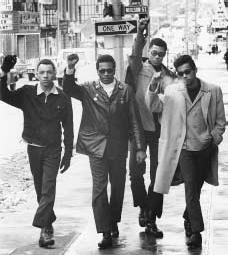 Four Black Panther Party members giving the Black Power salute. AP/WIDE WORLD PHOTOS. REPRODUCED BY PERMISSION.