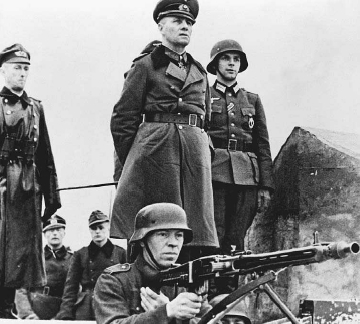 German Field Marshall Erwin Rommel and his staff inspect Atlantic sea wall fortifications in France, March 1944. The fortifications failed to repel the Allied D-Day assault that began ten weeks later. © BETTMANN-CORBIS