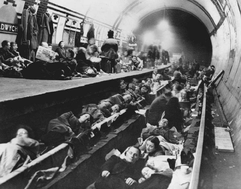 Londoners sleep in a subway station used as an air raid shelter during bombing by German planes, October 1940. © BETTMANN/CORBIS