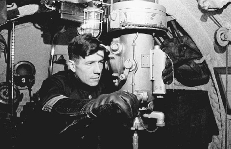 A Soviet navy officer aboard a submarine looks through a periscope, 1942. Soviet submarines, developed with help from Germany during the 1930s, were later used to interrupt German supply shipments in the North Sea. © YEVGENY KHALDEI/CORBIS