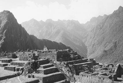 The impressive ruins of Machu Picchu, nestled among the peaks of the Andes Mountains. Photograph by John M. Barth. Reproduced by permission.