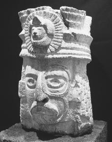 Maya sculpture of the head of a man with tattoos.  Gianni Dagli Orti/Corbis.