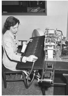 Grace Hopper works on a 1944 manual tape punch, which was an early computer. (Bettmann/Corbis)