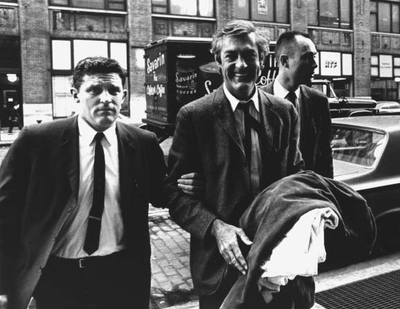 Dr. Timothy Leary, center, in custody, being led to U.S. Customs House at La Guardia Airport, 1966.