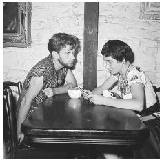 The coffeehouse became a symbol of the Beat generation during the 1950s and early 1960s. The Gaslight Coffeehouse in New York's Greenwich Village was once a well-known setting for various bohemian movements. This 1959 photo shows poet Dick Woods sitting over coffee with Eddy Slaton. © BETTMANN/CORBIS.