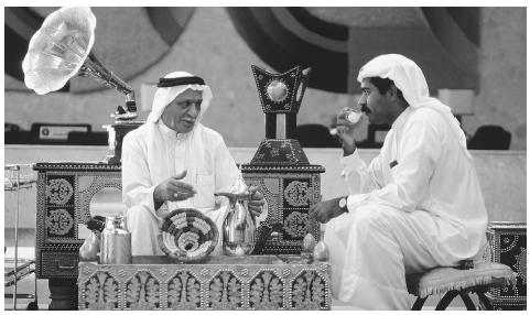 In the Arab world, the coffee break is much more than a pause in the day's schedule; it is a period of intense conversation and male socialization. These men are talking business over their cup of coffee in the Gulf Hotel at Manama, Bahrain. © ADAM WOOLFITT/CORBIS.