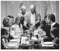 Thanksgiving dinner is one of the most important occasions for American families of all faiths and ethnic backgrounds to come together and enjoy a large home-cooked meal. © STEVE CHENN/CORBIS.
