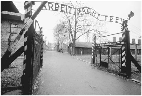 Beyond a front gate ironically proclaiming Work Shall Set You Free stood the elaborate death camp at Auschwitz, preserved as a monument to Nazi depravity and the victims of the Holocaust. [CORBIS]