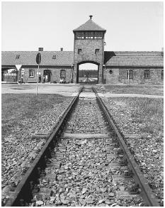 The main entrance at Birkenau. In the former Polish town of Oswiecim, the Nazis built Auschwitz I, the original concentration camp; Auschwitz II (Birkenau), an extermination center; and Auschwitz III (Monowice), essentially a labor camp for IG