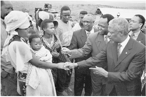 UN Secretary General Kofi Annan shakes hands with a survivor of the Rwandan genocide, May 1998. It was during this trip to Rwanda that Annan apologized to the Parliament of Rwanda for the United Nations great failure to intervene. [AP/WORLD WID
