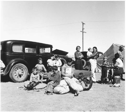 Many families abandoned their farms during the Dust Bowl and traveled west in search of work. Dorothea Lange photographed this family group from Texas at an overnight roadside camp near Calipatria, California, in 1937. LIBRARY OF CONGRESS, PRINTS & PHOTOGRAPHS DIVISION, FSA/OWI COLLECTION