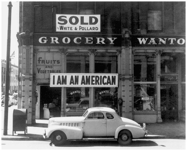 Evacuation is a euphemism for forced, unwarranted removal. Here, a Japanese American storeowner in Oakland, California protests the unconstitutional evacuation. (National Archives)