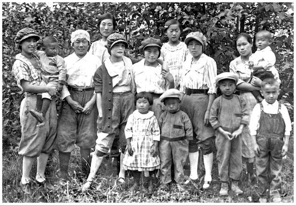 Issei, first-generation Japanese Americans, and their children, the nisei or second generation, at a garden club meeting in Oregon, July 1924. (Underwood Archives)