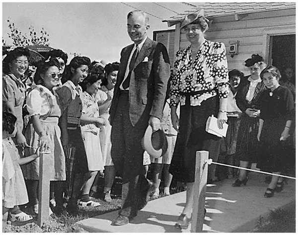 First Lady Eleanor Roosevelt, with War Relocation Authority head Dillon Myer, visited the Gila River concentration camp in 1943. Privately, Mrs. Roosevelt condemned the camps, but publicly supported them. (National Archives)