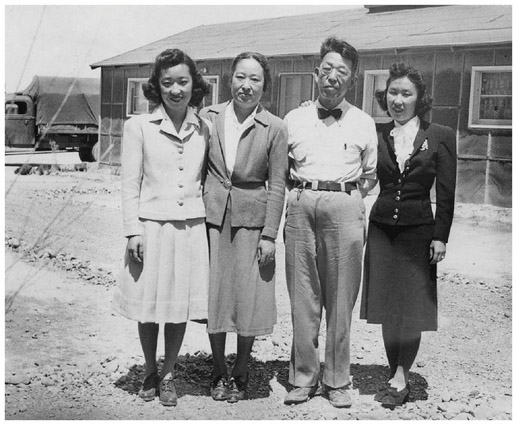Yoshiko Uchida (left), parents, and sister (right) on the day of their departure from Topaz concentration camp in 1943. (The Bancroft Library, University of California)