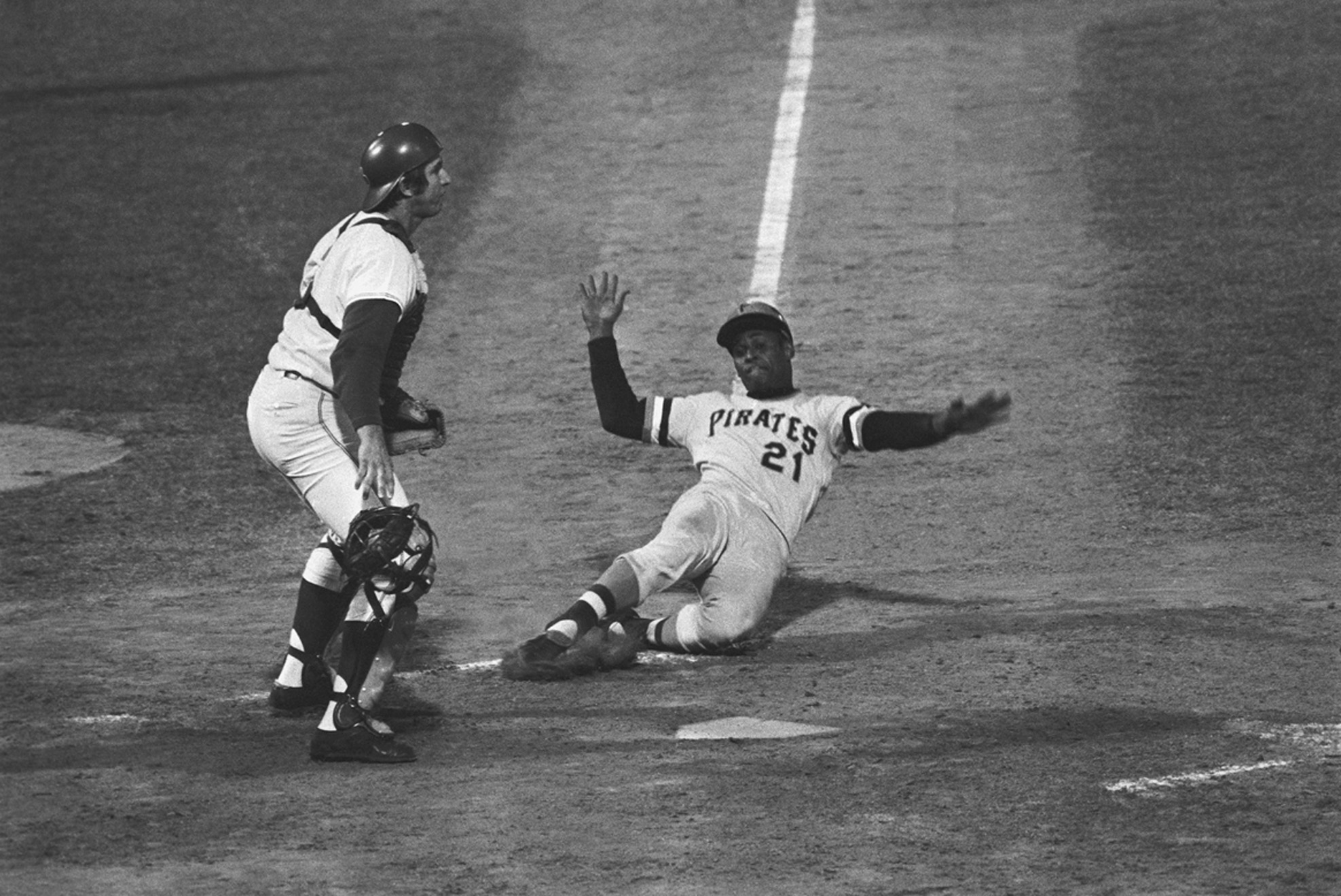 Roberto Clemente sliding into home base, 1971. Pittsburgh Pirates player Roberto Clemente became the first Latino elected to the Baseball Hall of Fame.