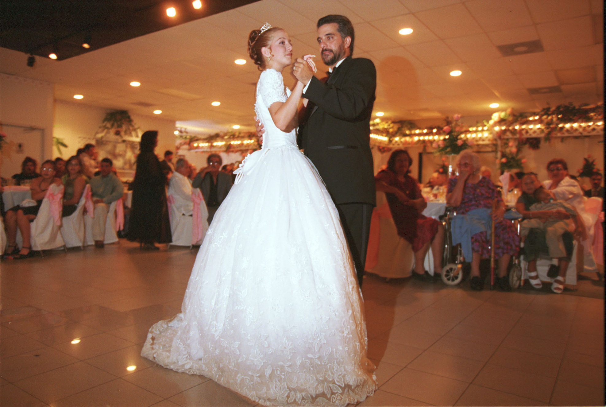 Celeste Vila dances with her father during her quincea era, 1999.