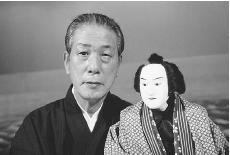 Famous Japanese puppeteer Yoshida Tamao holds a Bunraku puppet, c. 1979. (JACK FIELDS/CORBIS)