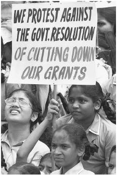 Indian schoolchildren and their parents in Mumbai in July 2001 protest a government decision to cut tuition grants for students attending English-language schools. (AFP/CORBIS)