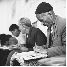 Older men attending a literacy class in Iran. (PAUL ALMASY/CORBIS)