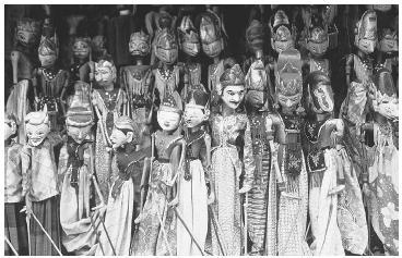 Wayang golek puppets in Solo, Indonesia, in the 1990s. (LINDSAY HEBBERD/CORBIS)
