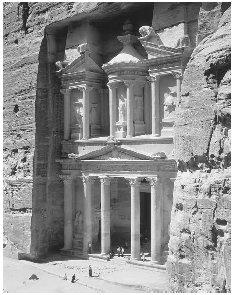 Nestled in the mountains of Jordan lie the ruins of Petra (known in the Bible as Sela), a fortress city carved out of high sandstone cliffs that once controlled the main commercial routes in the region. The ruins were rediscovered in 1812 by the Europeans, but were not fully surveyed and classified until the beginning of the twentieth century. © JOSE FUSTE RAGA/CORBIS. REPRODUCED BY PERMISSION.