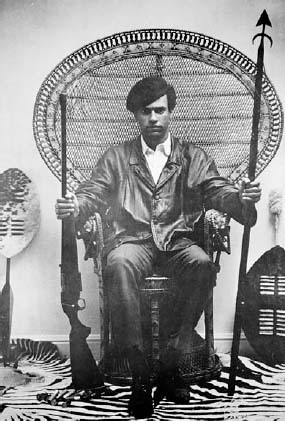 Huey P. Newton poses in Black Panther poster.