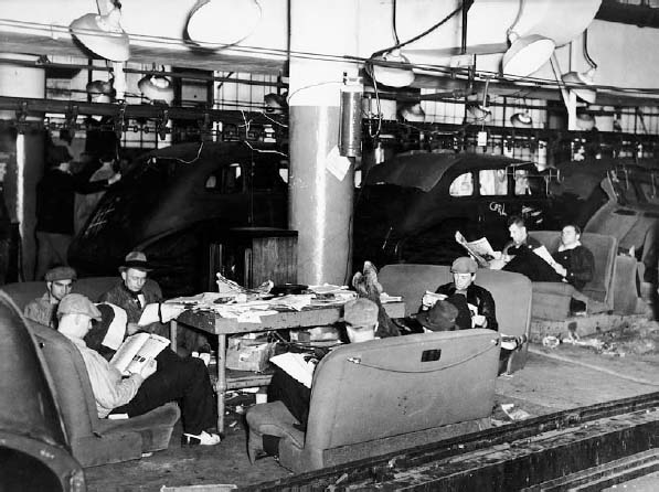 Members of the United Automobile Workers union stage a sit-down strike in the Fisher body plant factory in Flint, Michigan in 1936.